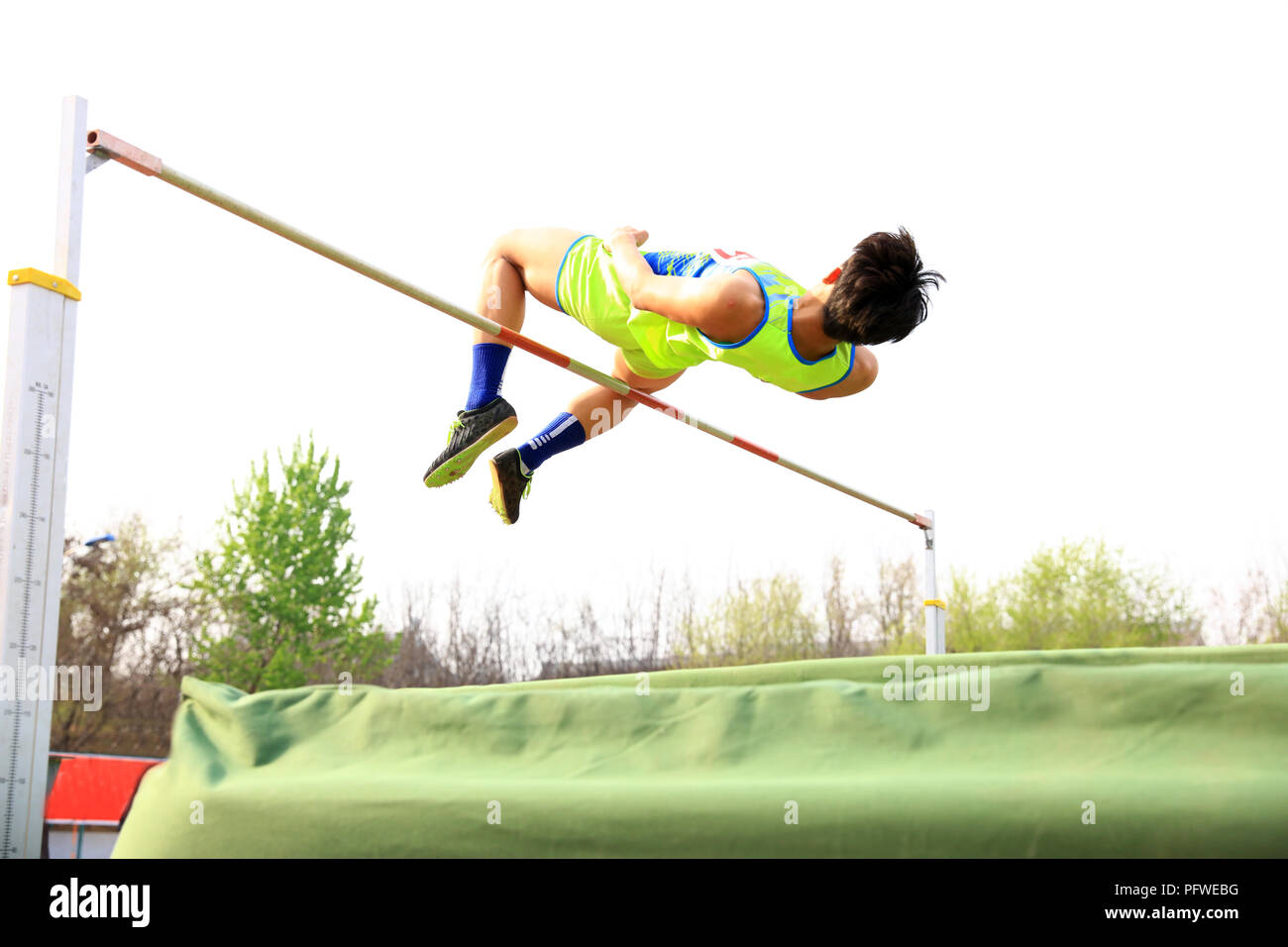 A male athlete is on the high jump - Stock Image