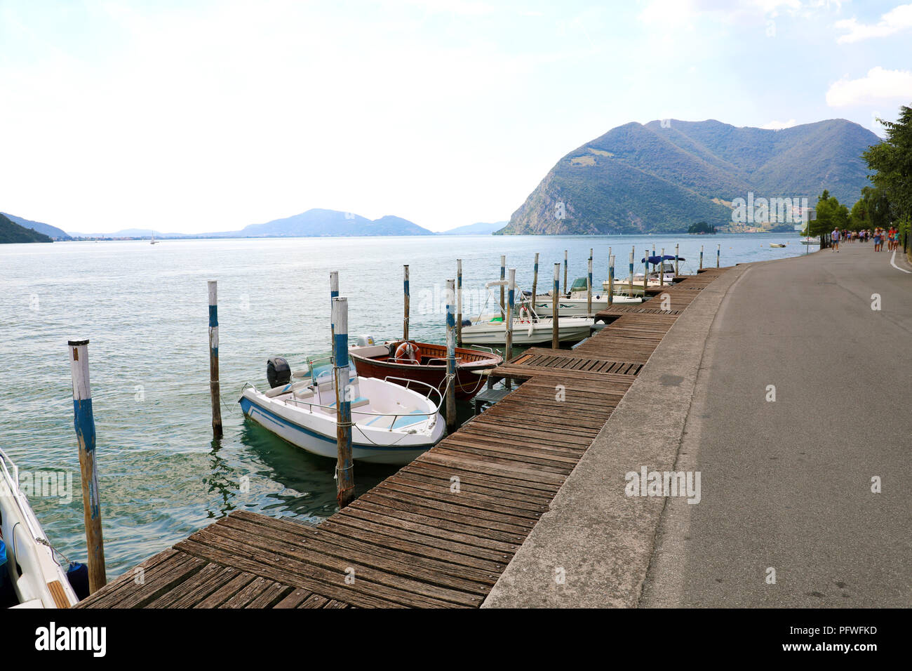 Boats moored in Peschiera Maraglio with Lake Iseo on the background, Monte Isola, Italy - Stock Image