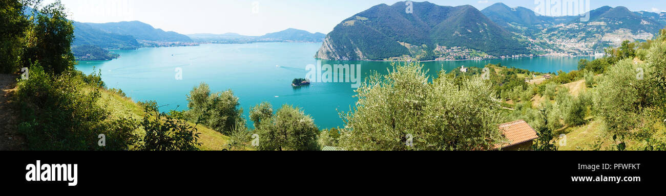 Panoramic view of mountain lake with island in the middle. Panorama from Monte Isola Island with Lake Iseo. Italian landscape. Island on lake. View fr Stock Photo