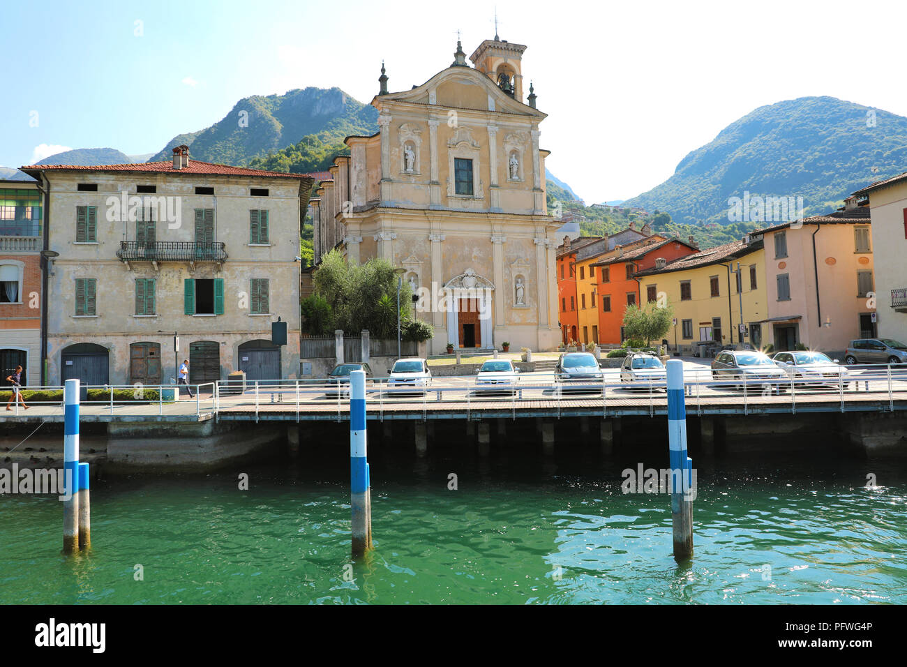 MONTE ISOLA, ITALY - AUGUST 20, 2018: view of small village with church on Monte Isola island in the middle of Lake Iseo, Italy - Stock Image