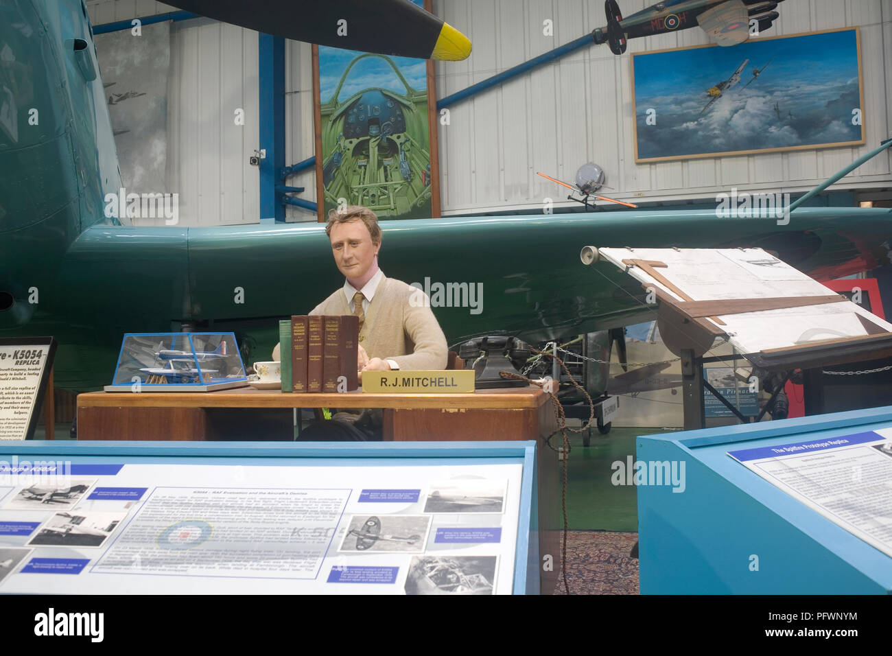 Mock up of Spitfire engineer R J Mitchell in Merston Hall at Tangmere military aviation museum - Stock Image