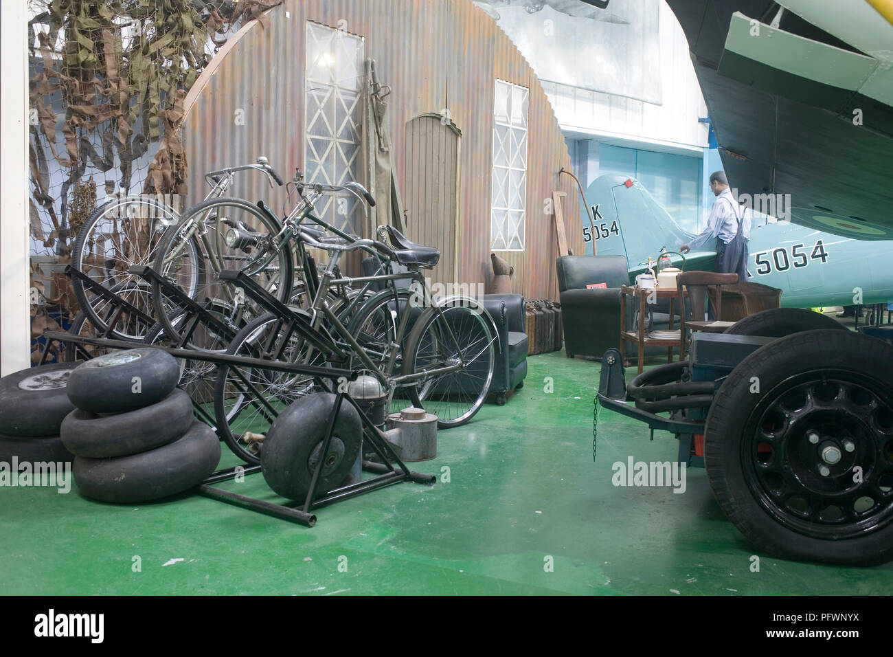 Aircraft tyres, bicycles and replica hangar in Merston Hall at Tangmere militray aviation museum - Stock Image