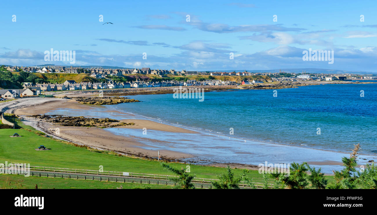 BUCKIE MORAY SCOTLAND BLUE SEA AND THE TOWN AND HOUSES ALONG THE COAST ROAD IN MID SUMMER - Stock Image