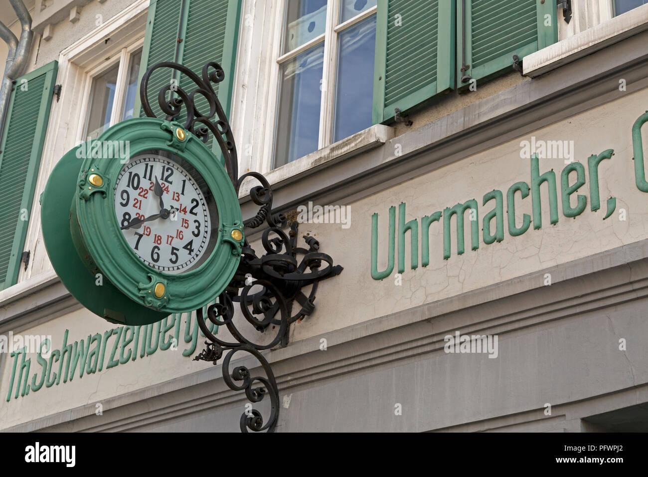 clock at a clockmaker´s house, Isny, Allgaeu, Baden-Wuerttemberg, Germany - Stock Image