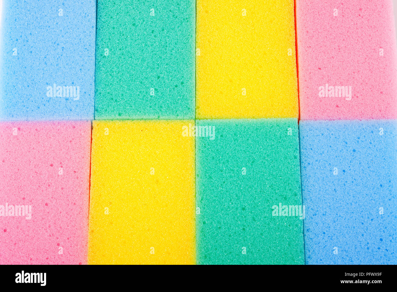 Background of colored kitchen sponges for washing dishes Stock Photo