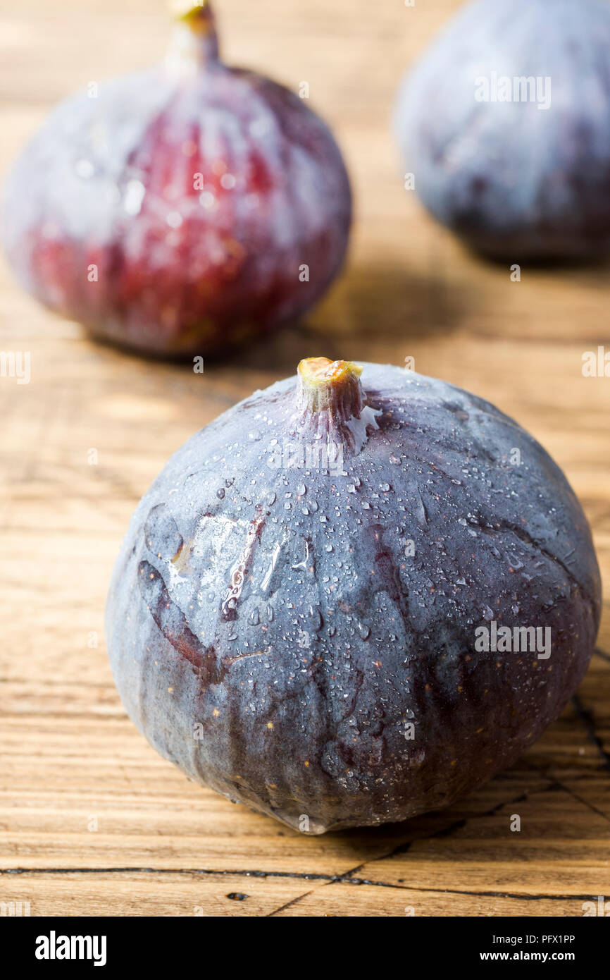 Figs are Fresh ripe on a wooden old background - Stock Image