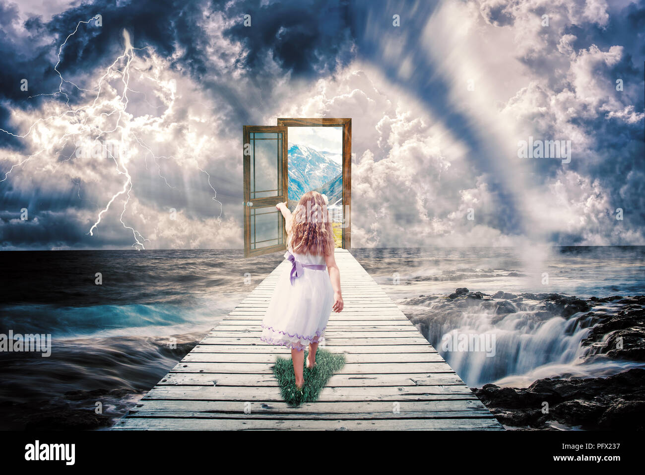 Photo manipulation of an apocalyptic scenery and a child walking towards a door containing a new world - Stock Image