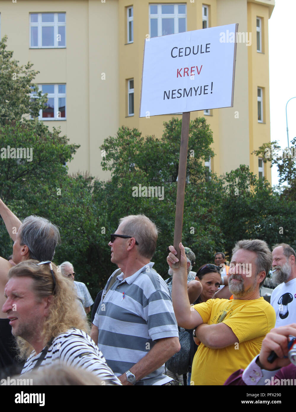 A several people protest after an unveiling of restored memorial to Soviet Marshal Konev with new plaques describing his life and work, in Prague, Cze Stock Photo