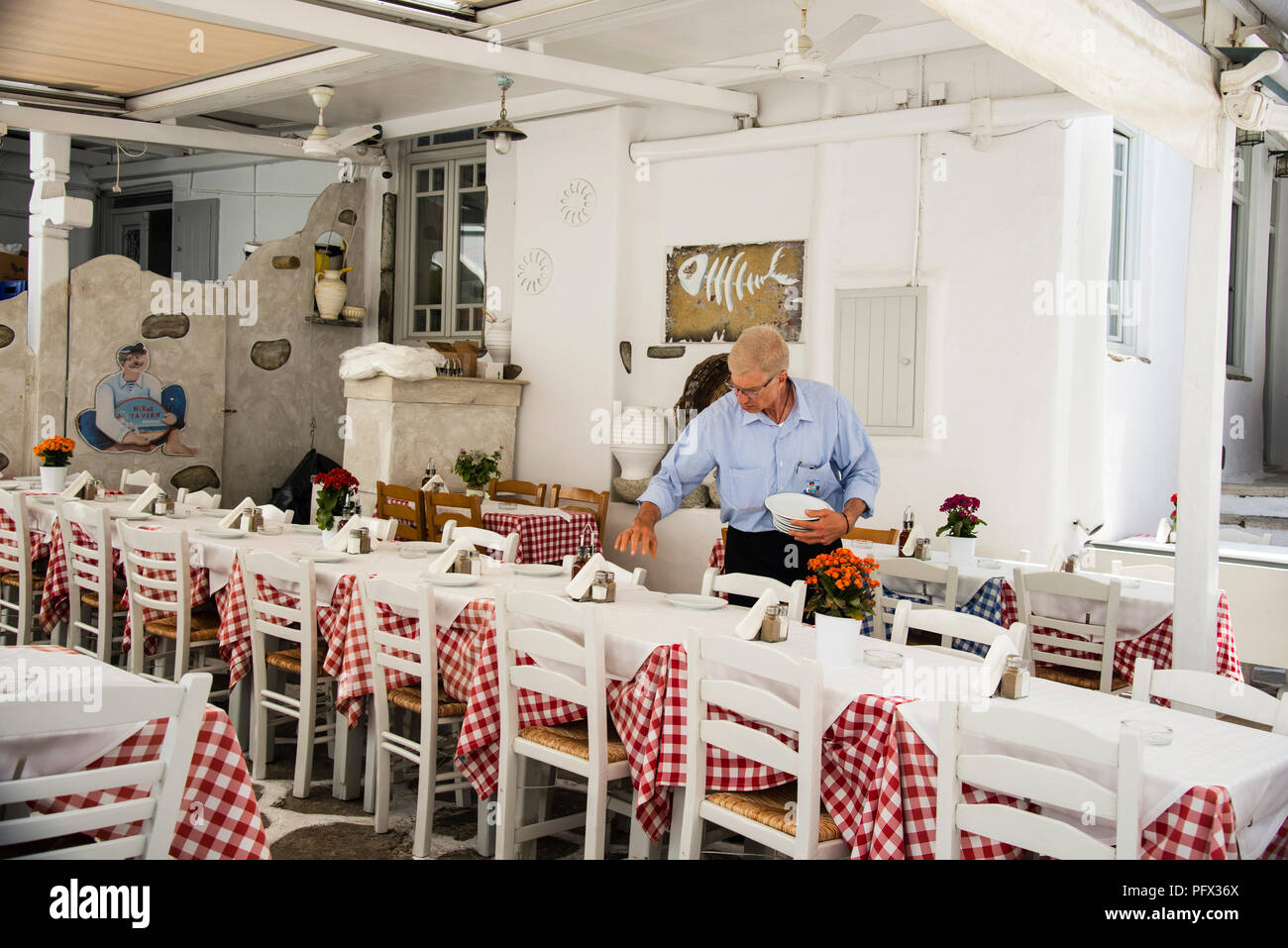 Preparing for Lunch in Greece - Stock Image