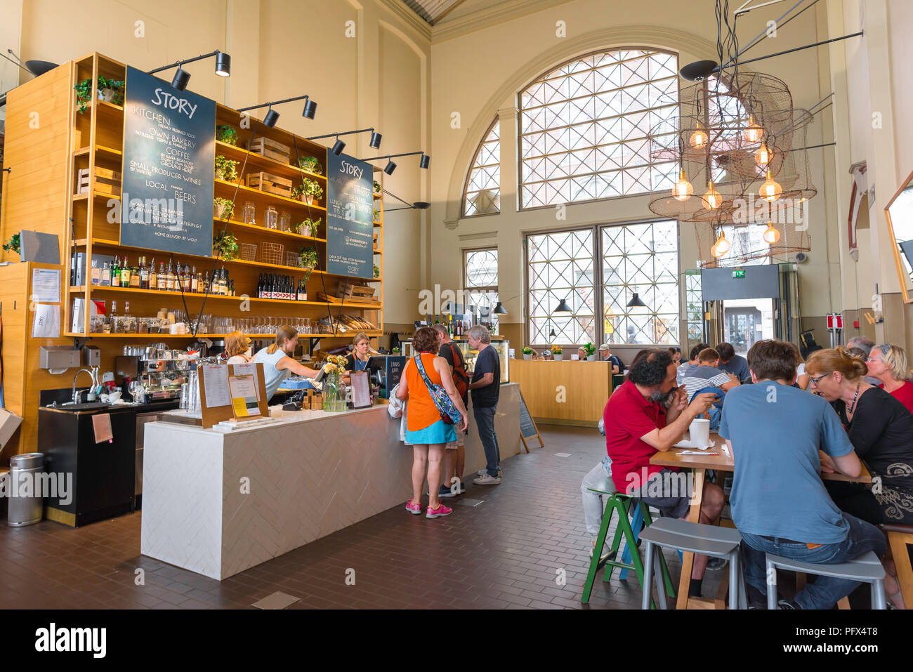 Helsinki cafe, view of the Story cafe bar inside the Vanha Kauppahalli (Market Hall) in the harbor area of Helsinki, Finland. - Stock Image
