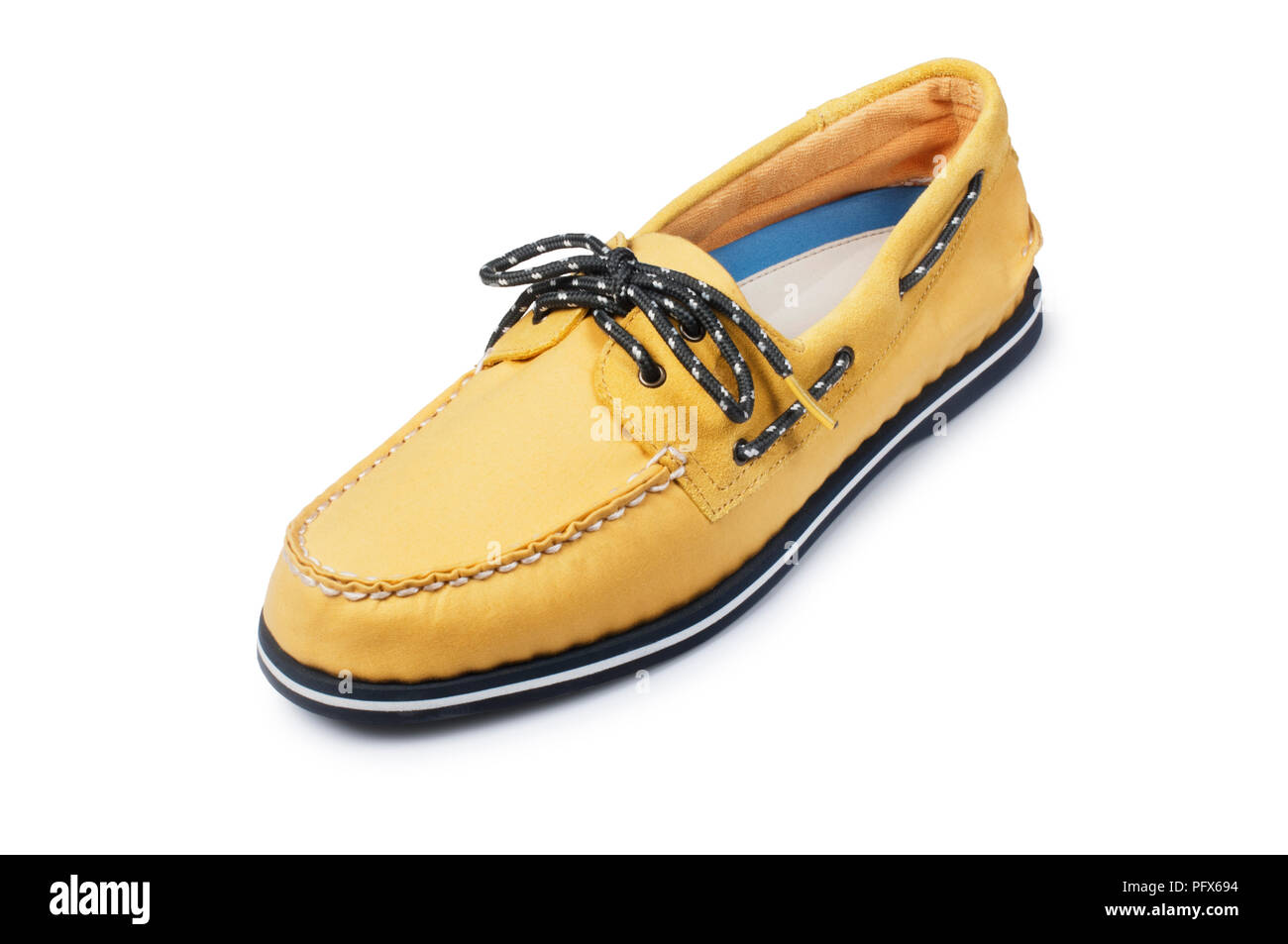 Studio shot of a mans yellow boat shoe isolated on white - John Gollop - Stock Image