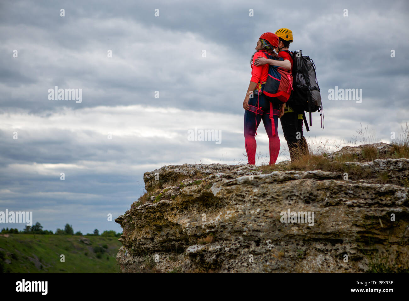 Photo from back of hugging man and woman tourist on mountain Stock Photo