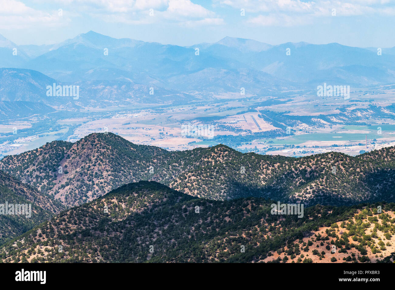 Forest fire smoke; high vantage point view of Harriett Alexander Air Field; Salida & Arkansas River Valley from The Crater; USA Stock Photo