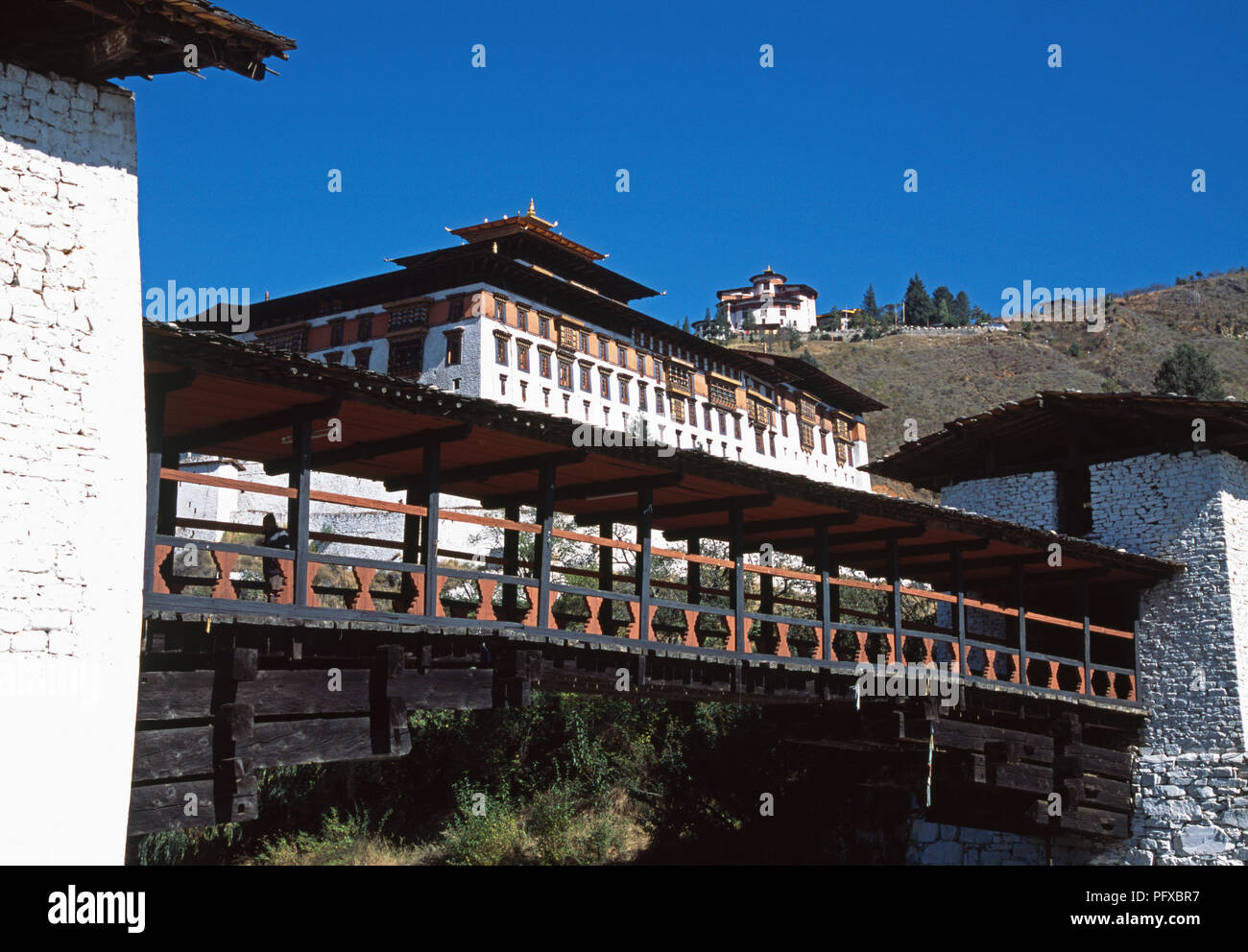 Reconstructed traditional bridge across Paro Chhu river to Rinpung Dzong in Paro district, Bhutan - Stock Image