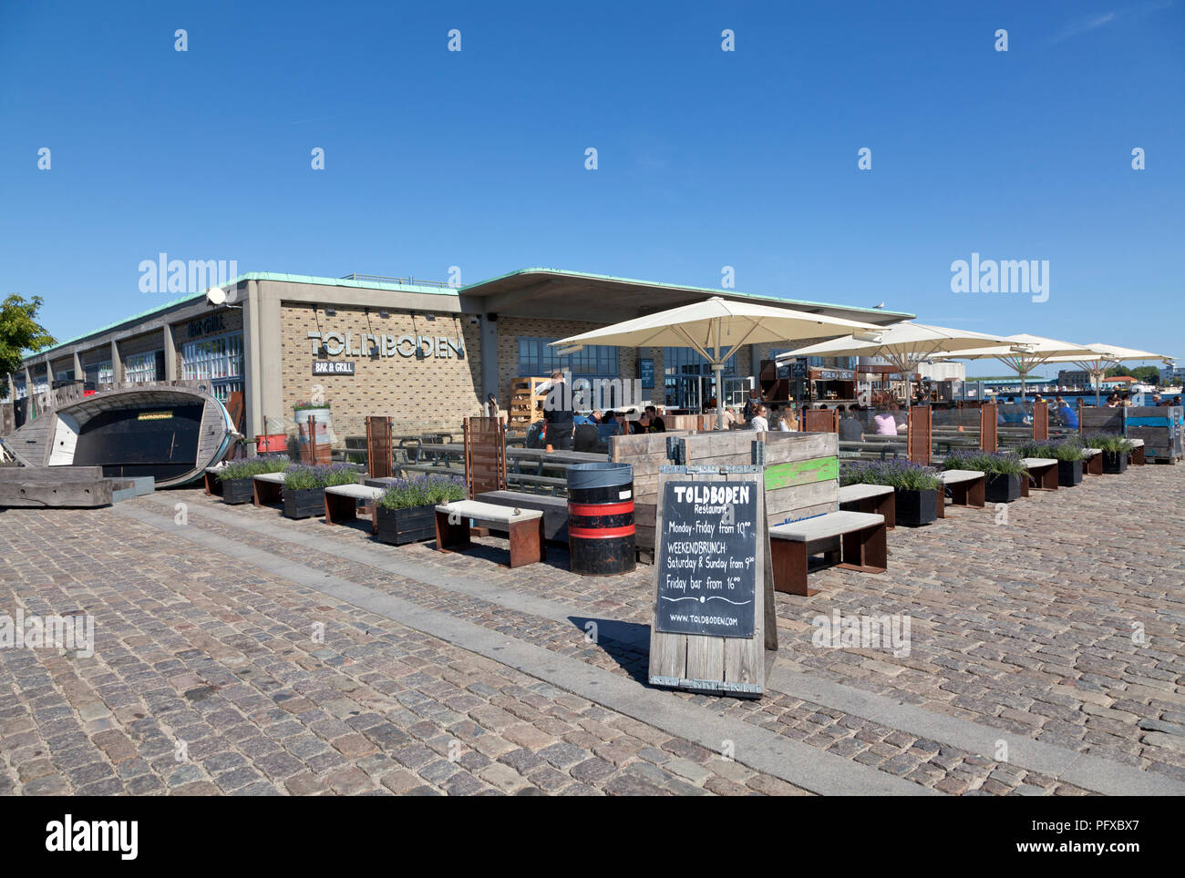 The restaurant, bar and café TOLDBODEN at Toldboden (the old custom house) next to Langelinie quay in the port of Copenhagen. Stock Photo