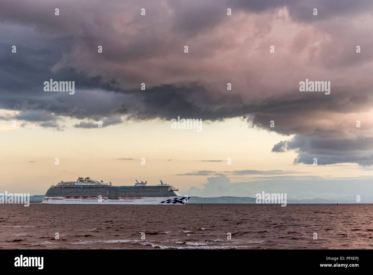 Royal Princess cruise liner off Crosby beach evening departure. - Stock Image