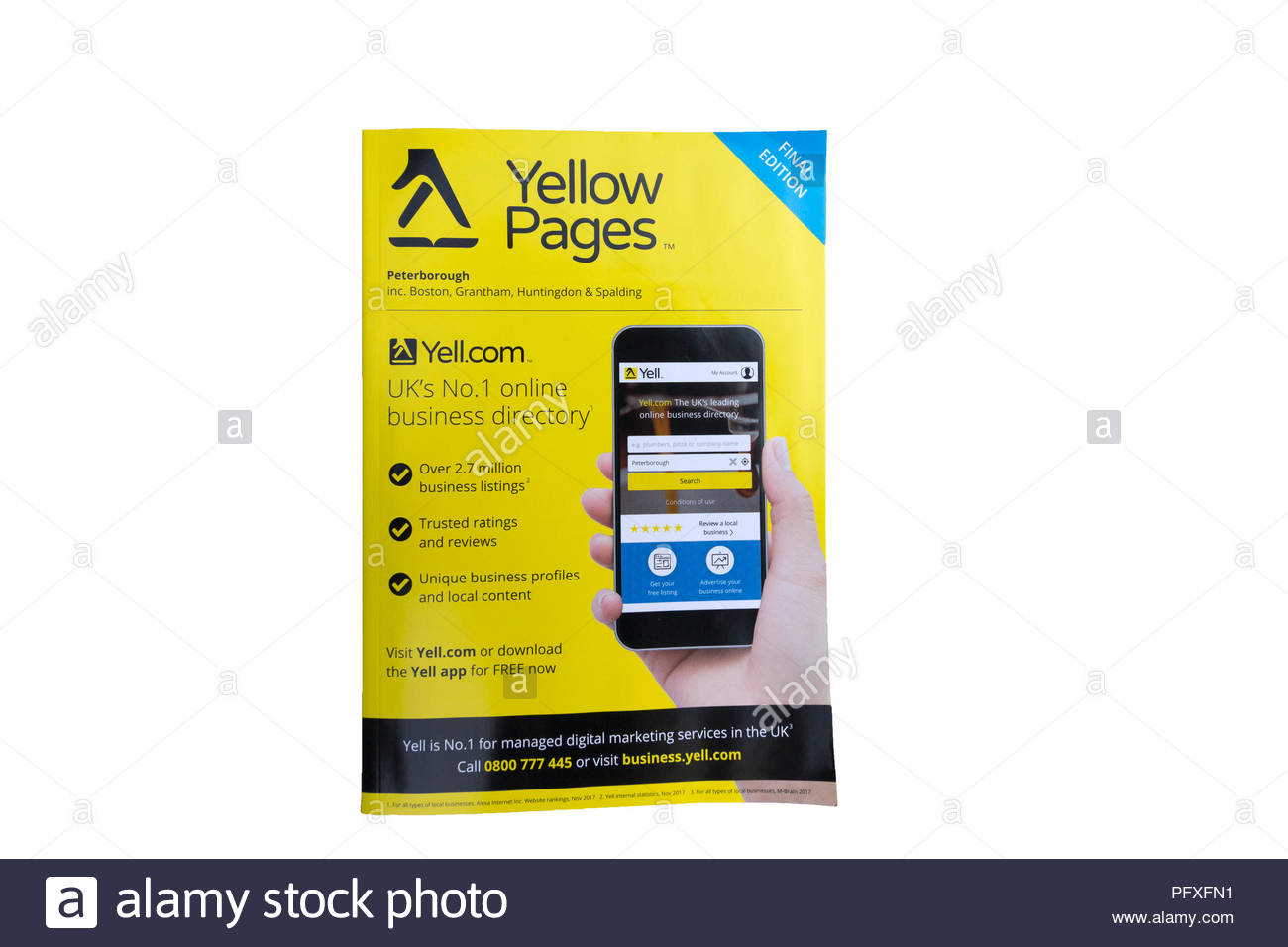 Last Edition of the Yellow Pages, isolated on a white background - Stock Image
