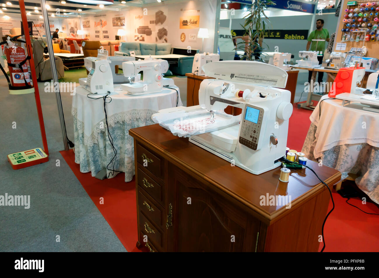 Husqvarna Viking automatic digital sewing and embroidery machine exhibited at the Fair Trade of Gijon 2018. August 16, 2018. Spain. - Stock Image