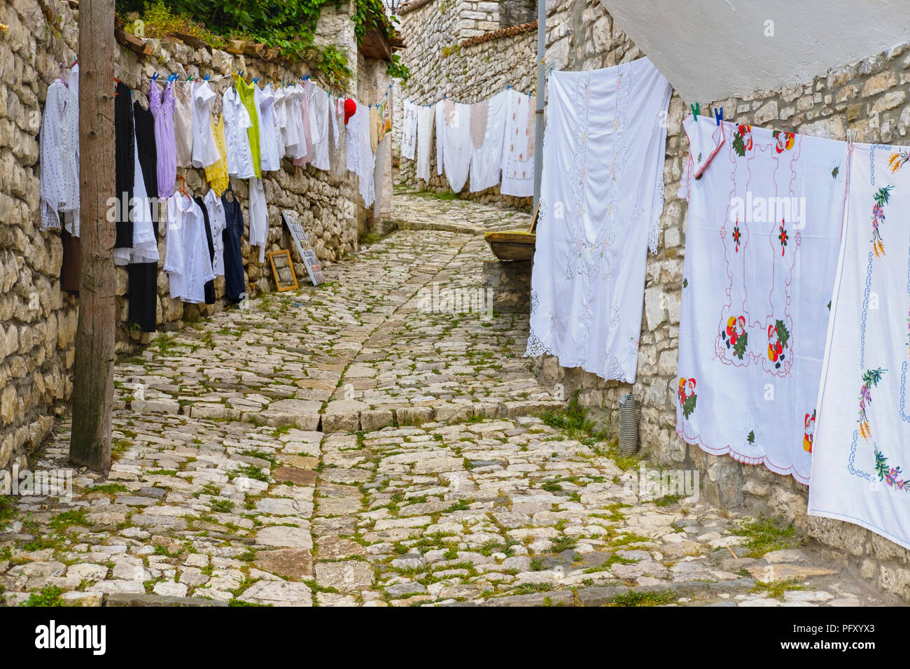 Alley with textile handicrafts, Berat, Qark Berat, Albania - Stock Image