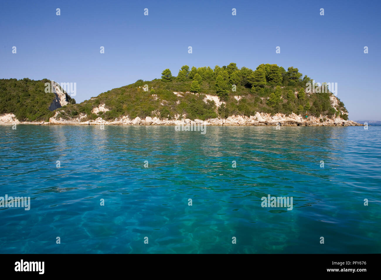 Headland at the entrance to the bay at Lakka, Paxos, Greece - Stock Image