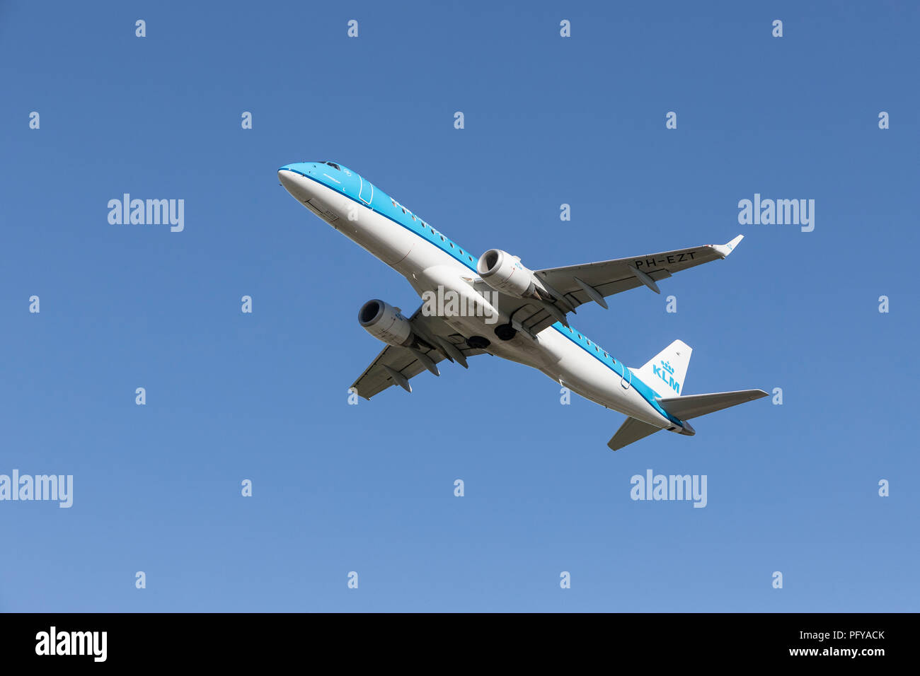 Airborne KLM Embraer twin engined airliner, PH-EZT - Stock Image