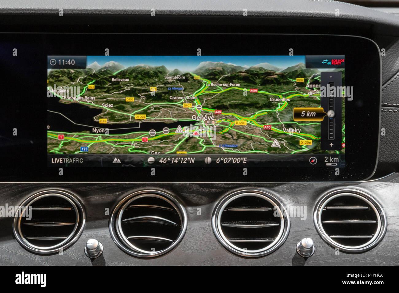 GENEVA, SWITZERLAND - MARCH 7, 2018: Interior dashboard naviagation display in the new Mercedes Benz E300 Diesel Hybrid car at the 88th Geneva Interna - Stock Image