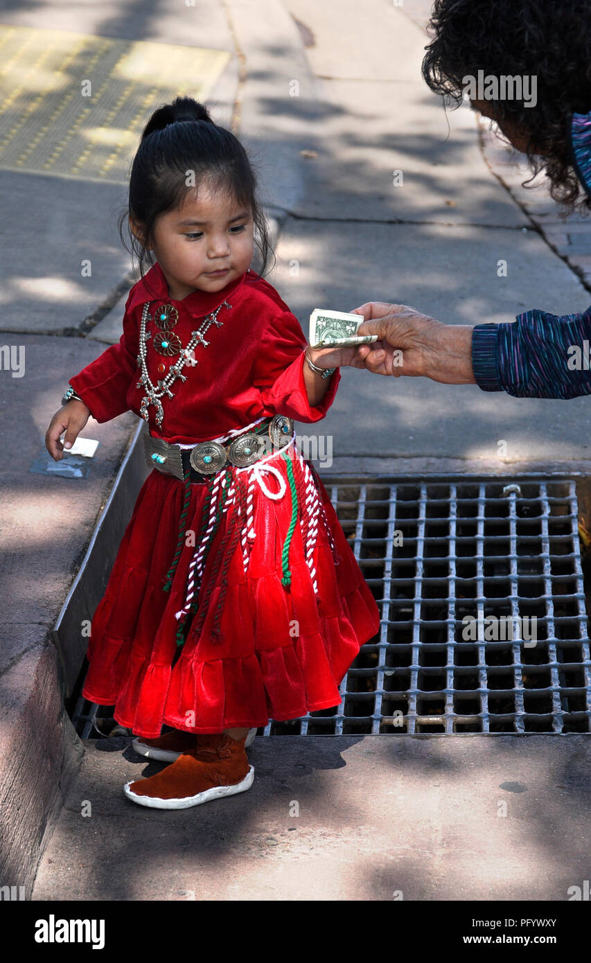 A young Navajo girl in traditional Navajo clothing and jewelry at the Santa Fe Indian Market - Stock Image