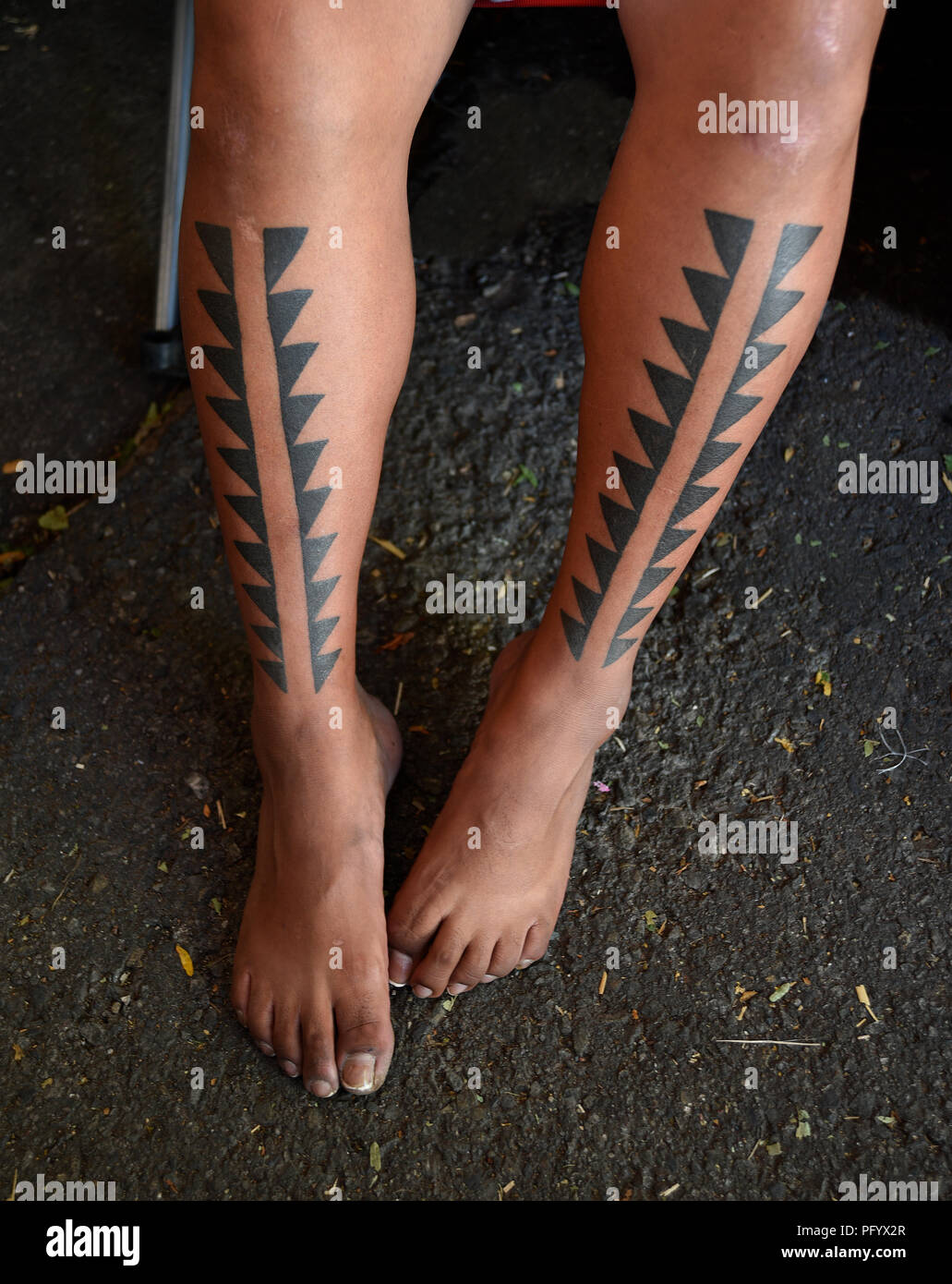 Native American Design Tattoos On The Legs Of A Native American