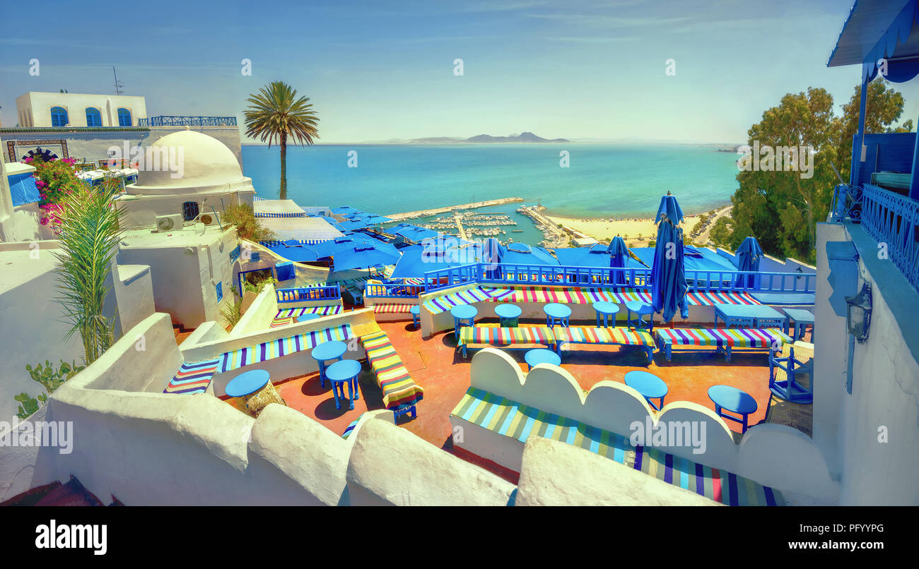 Panoramic view of seaside and cafe terrace in Sidi Bou Said at sunset. Tunisia, North Africa - Stock Image