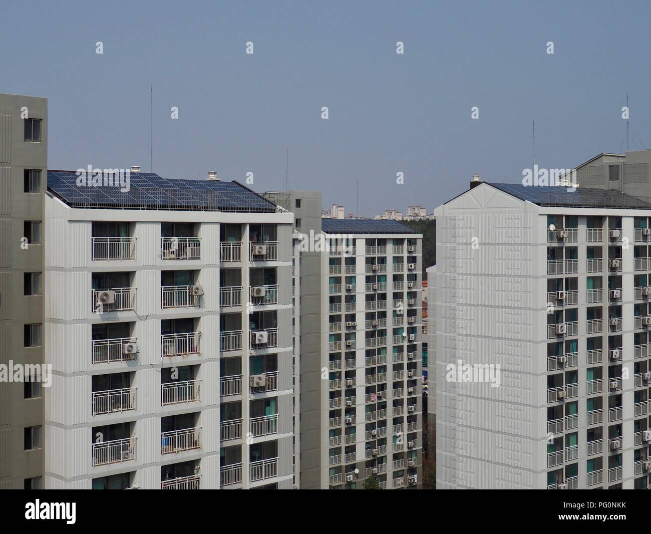 Apartment in South Korea with solar panels - Stock Image