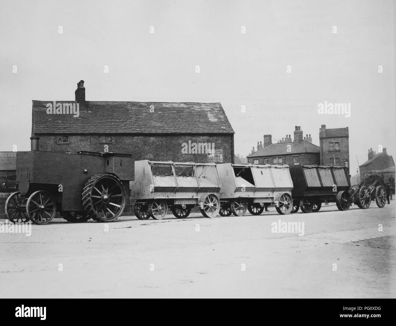 1900 Fowler armoured traction engine with munitions train - Stock Image