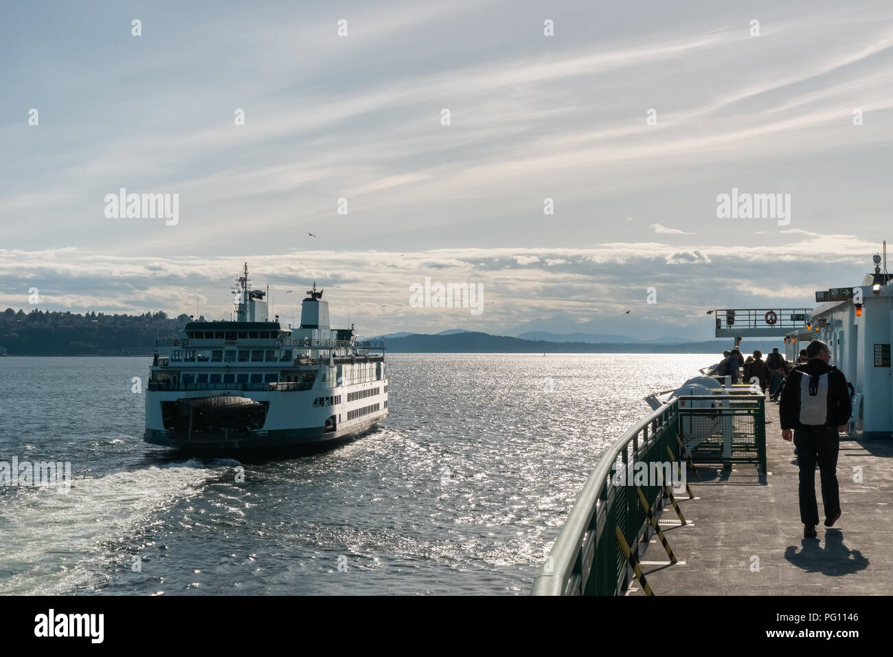 Washington state ferry boat on the Puget on late afternoon after having left the Seattle terminal, USA. - Stock Image