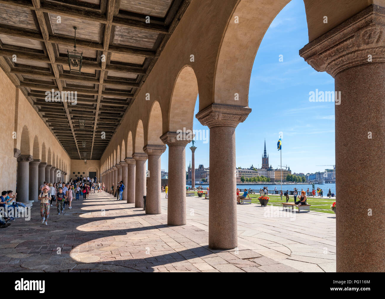 View of Riddarholmen in Gamla Stan (Old Town) from arcade under Stockholm City Hall (Stadshuset), Kungsholmen, Stockholm, Sweden - Stock Image