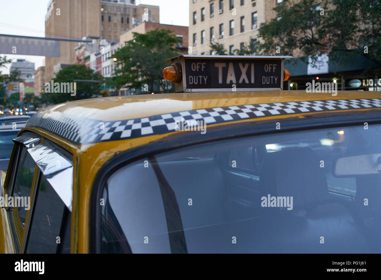 taxi occupancy sign on roof of vintage Chekers taxicab in New York City - Stock Image
