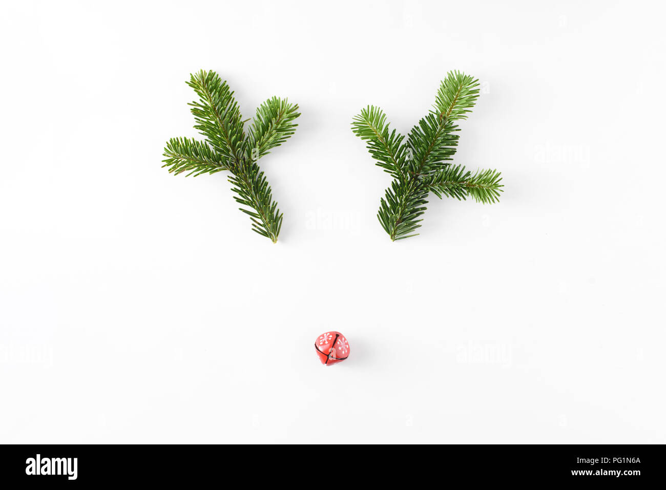 Christmas deer funny face made of fir-tree branches and little red ...