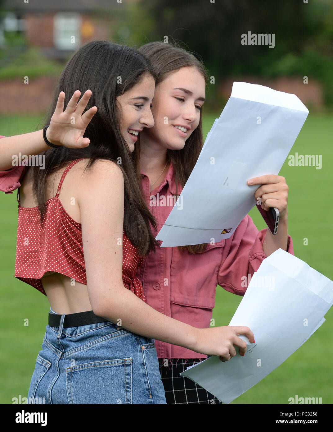 Manchester, UK. 23rd Aug, 2018. Sophie Ruben (left) and Abby Brown (right) celebrate their GCSE results at Withington Girl's School, Manchester. Photograph by Credit: Howard Walker/Alamy Live News Stock Photo
