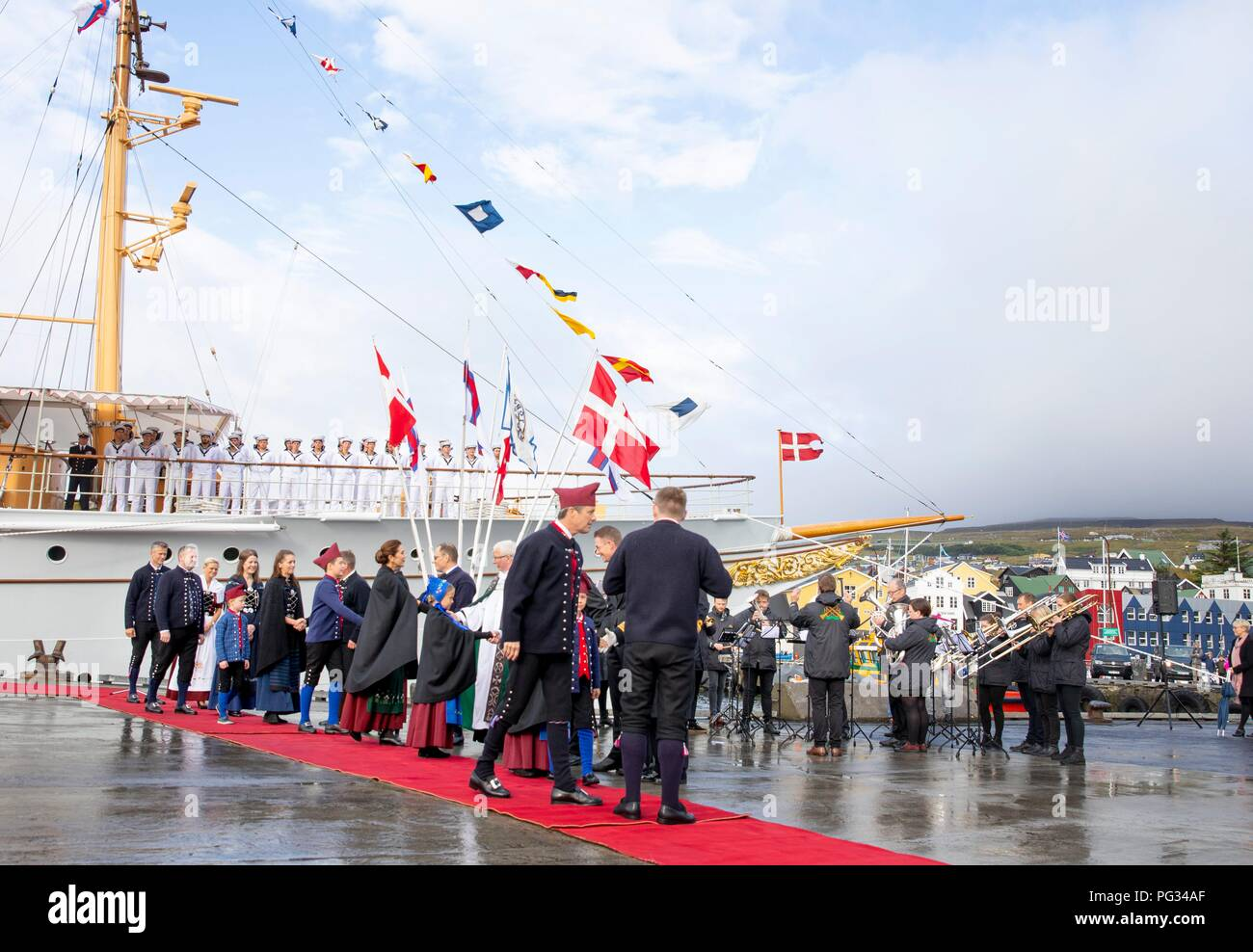 Torshavn, Faroe Islands, Denmark. 23rd Aug, 2018. Crown Prince Frederik, Crown Princess Mary, Prince Christian, Princess Isabella, Prince Vincent and Princess Josehpine of Denmark arrive with the The Royal Ship, HDMY Dannebrog at Bursatangi, on August 23, 2018, on the 1st of the 4 days visit to the Faroe Islands Photo : Albert Nieboer/ Netherlands OUT/Point de Vue OUT | Credit: dpa/Alamy Live News - Stock Image