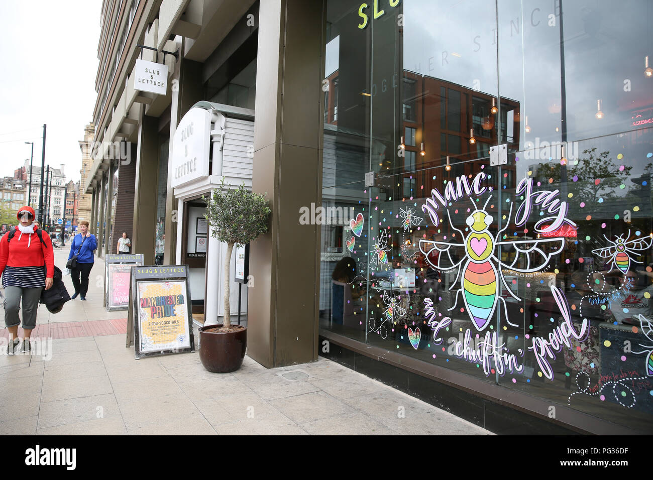 Manchester, UK. 23rd August, 2018. A window decorated with a Bee and the words 'Manc gay and chuffin proud' as Preparations take place in the city for the Gay Pride Big Weekend, Manchester. 23rd August, 2018 (C)Barbara Cook/Alamy Live News - Stock Image