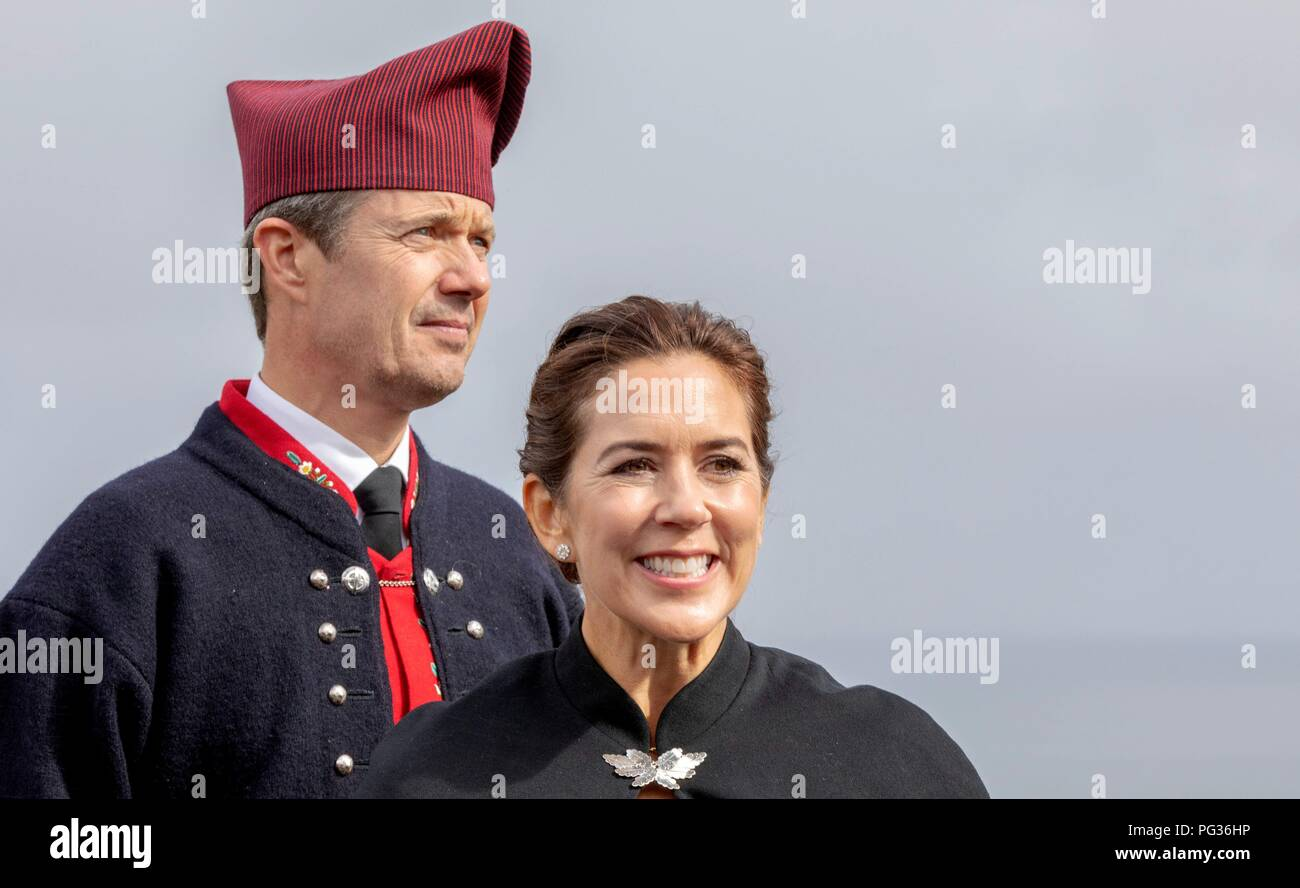 Torshavn, Faroe Islands, Denmark. 23rd Aug, 2018. Crown Prince Frederik and Crown Princess Mary of Denmark arrive with the The Royal Ship, HDMY Dannebrog at Bursatangi, on August 23, 2018, on the 1st of the 4 days visit to the Faroe Islands Photo : Albert Nieboer/ Netherlands OUT/Point de Vue OUT | Credit: dpa/Alamy Live News - Stock Image