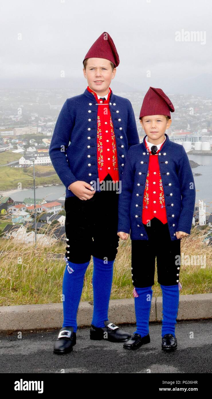 Torshavn, Faroe Islands, Denmark. 23rd Aug, 2018. Prince Christian and Prince Vincent of Denmark arrive with the The Royal Ship, HDMY Dannebrog at Bursatangi, on August 23, 2018, on the 1st of the 4 days visit to the Faroe Islands Photo : Albert Nieboer/ Netherlands OUT/Point de Vue OUT | Credit: dpa/Alamy Live News - Stock Image