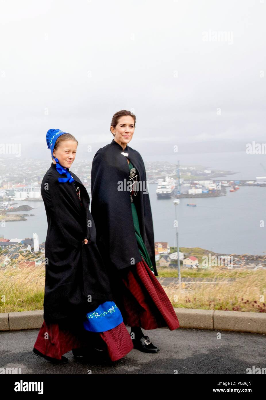 Torshavn, Faroe Islands, Denmark. 23rd Aug, 2018. Crown Princess Mary and Princess Isabella of Denmark arrive with the The Royal Ship, HDMY Dannebrog at Bursatangi, on August 23, 2018, on the 1st of the 4 days visit to the Faroe Islands Photo : Albert Nieboer/ Netherlands OUT/Point de Vue OUT | Credit: dpa/Alamy Live News - Stock Image