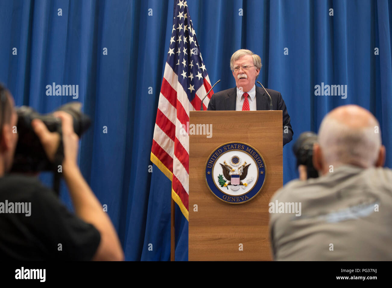 Geneva, Switzerland. 23rd Aug, 2018. U.S. National Security Advisor John R. Bolton speaks during a press conference in Geneva, Switzerland, Aug. 23, 2018. A meeting between U.S. National Security Advisor John R. Bolton and his Russian counterpart, Security Council Secretary Nikolai Patrushev, concluded Thursday afternoon here in Geneva without reaching a joint statement though both sides cited 'progress'. Credit: Xu Jinquan/Xinhua/Alamy Live News - Stock Image