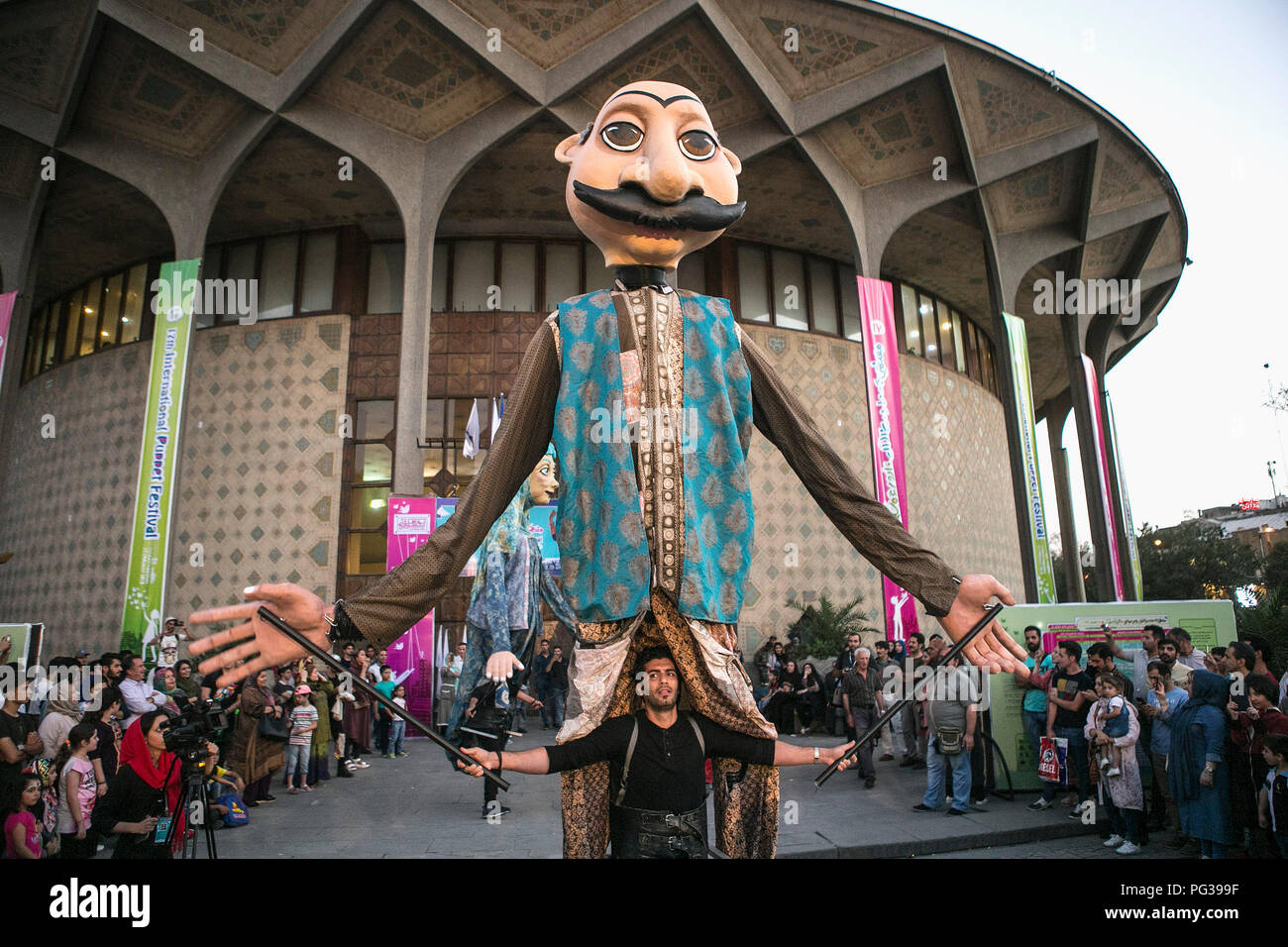 Tehran, Iran. 23rd Aug, 2018. An actor performs during the 17th Tehran International Puppet Theater Festival in downtown Tehran, capital of Iran, on Aug. 23, 2018. The six-day-long festival opened here on Wednesday. Credit: Ahmad Halabisaz/Xinhua/Alamy Live News - Stock Image
