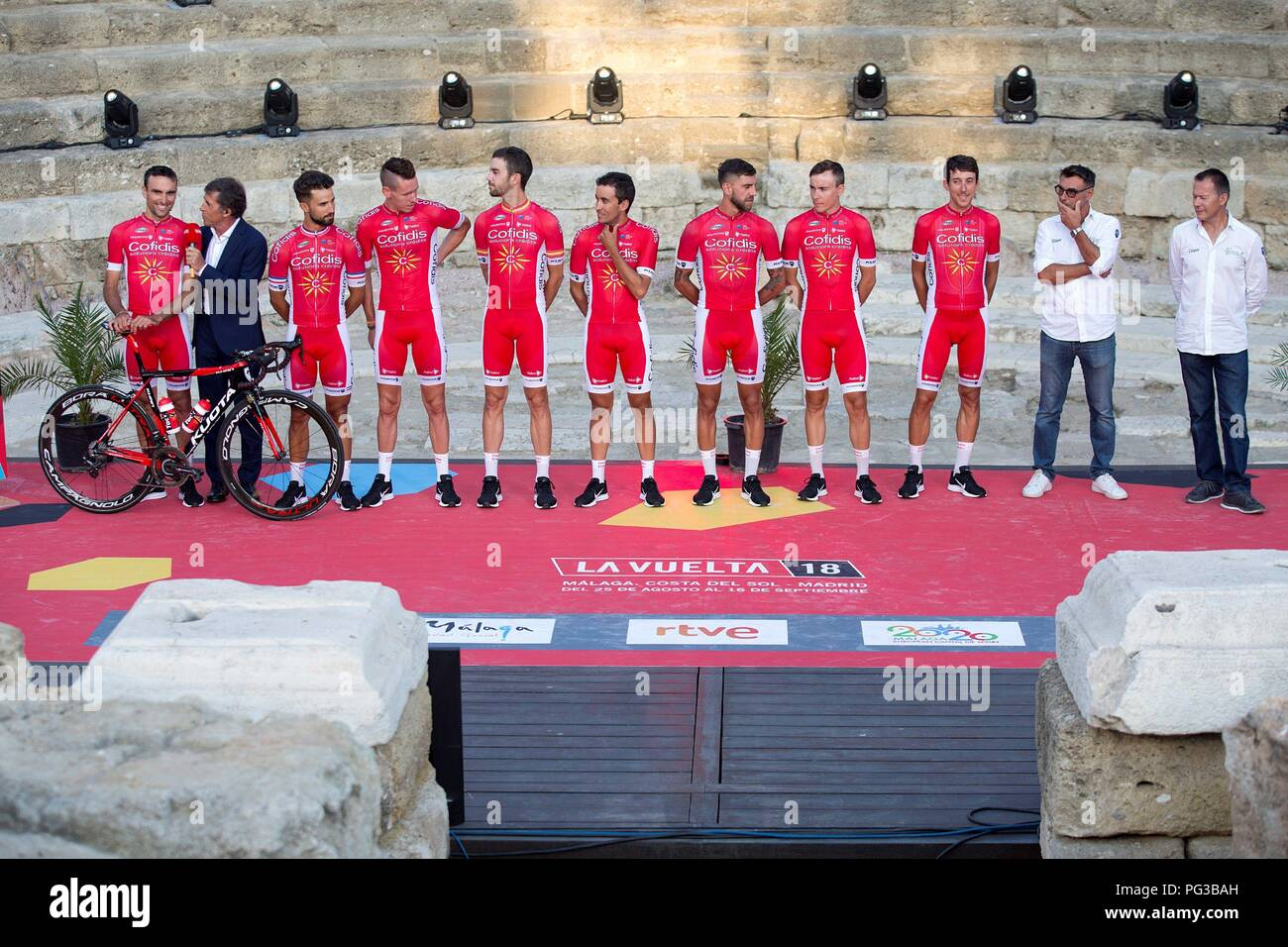 Malaga, Spain. 24th August, 2018. Cofidis cycling team's members pose on the stage at Roman Theater during the presentation of the cycling teams competing in La Vuelta cycling tour in Malaga, southern Spain, 23 August 2018 (issued on 24 August 2018). La Vuelta runs from 25 August to 16 September. EFE/ Daniel Perez Credit: EFE News Agency/Alamy Live News Stock Photo
