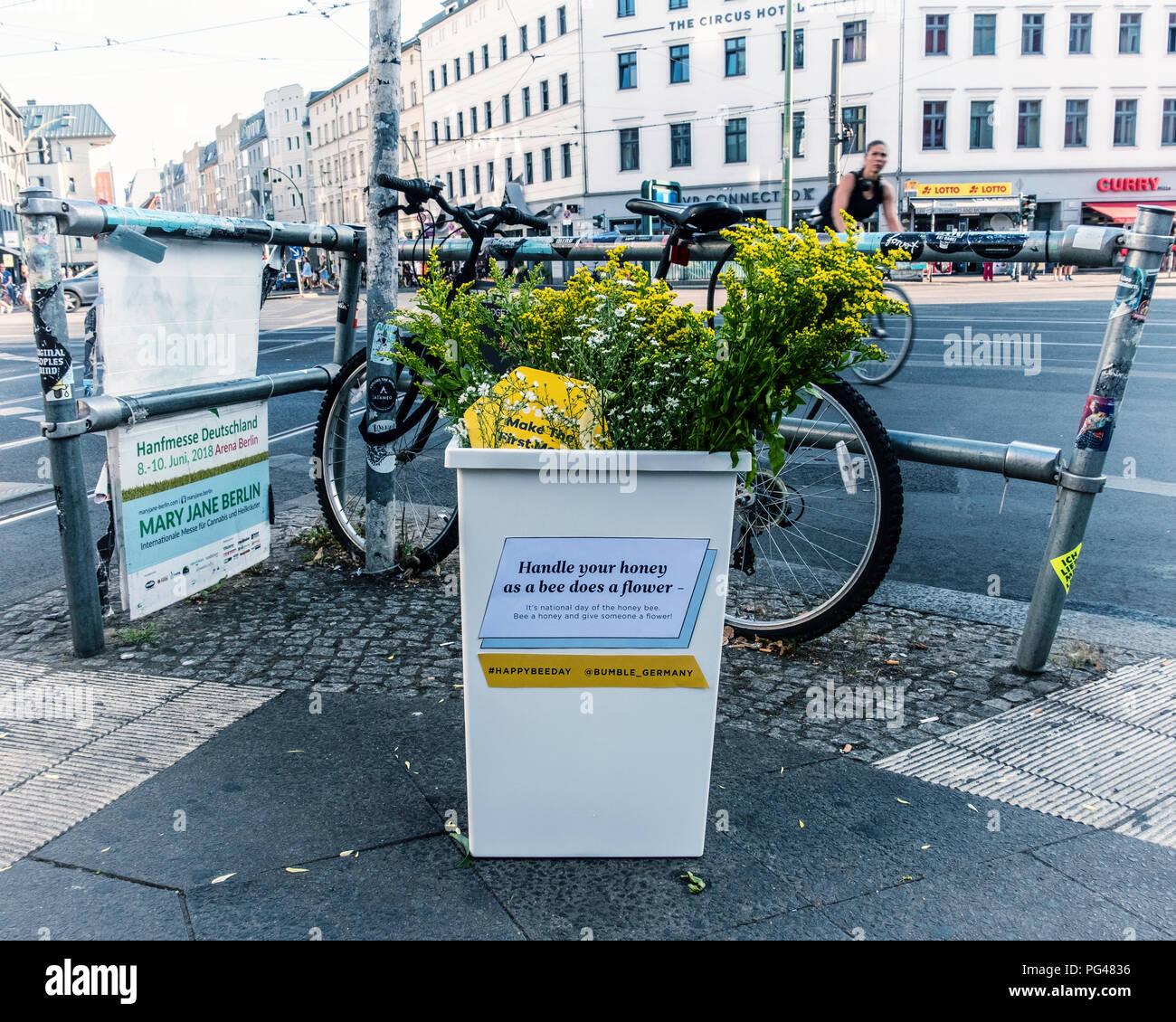 Berlin-Mitte, Rosenthalerplatz. Container of flowers on street corner on National Honey Bee day raises awareness for bee industry - Stock Image