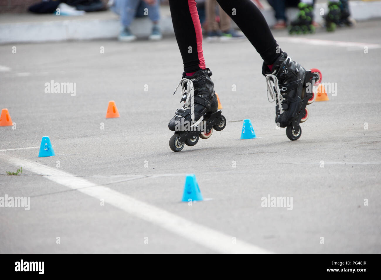 Competitions in roller sport.Roller skates and special chips - Stock Image