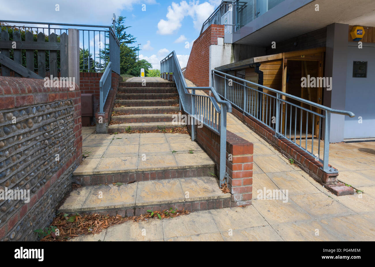 Stairs Next To A Wheelchair Ramp For Disabled Access Outdoors In  Chichester, West Sussex,