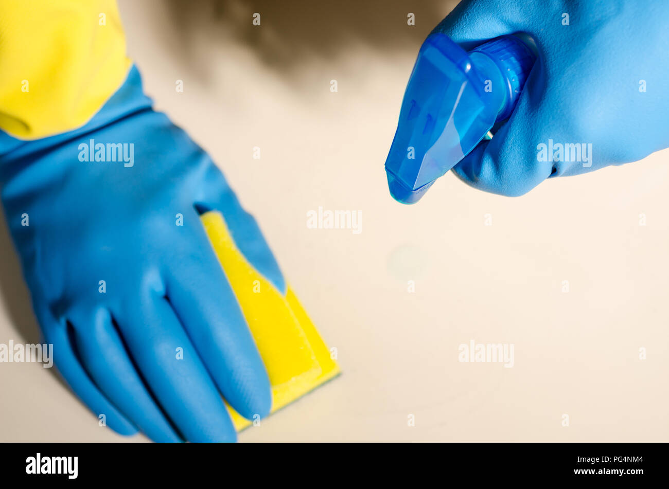 hands in rubber gloves cleaning the surfaces of ceramic tiles, safe and hygienic cleaning, keeping the house clean - Stock Image