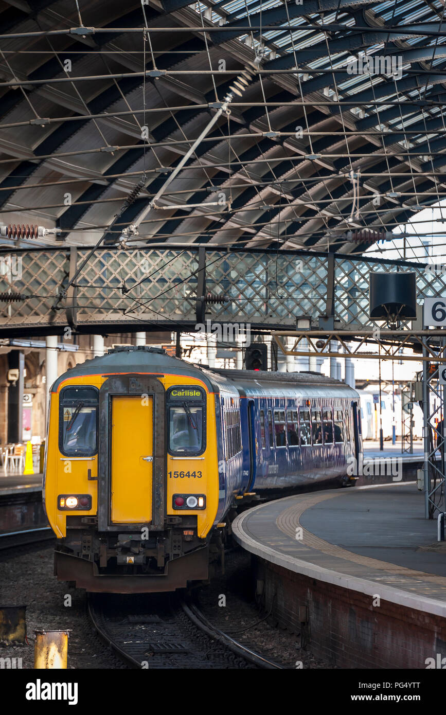 Northern Rail class 156 sprinter passenger train waiting at a station in Yorkshire, England. - Stock Image