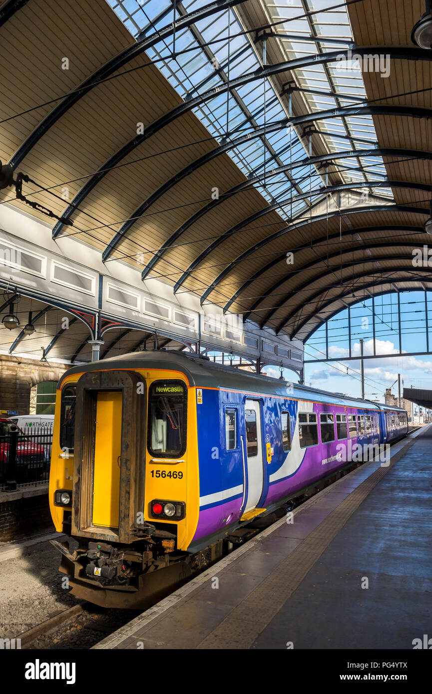 Northern Rail class 156 sprinter passenger train waiting at a station in England. - Stock Image